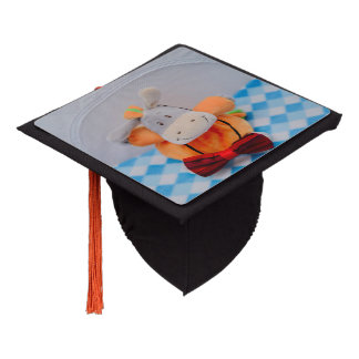 Cute toy with a red bow tie graduation cap topper
