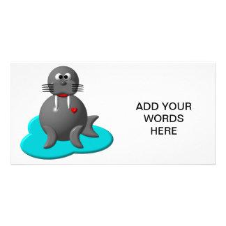 Cute walrus in water photo card