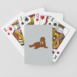 Cute walrus playing cards