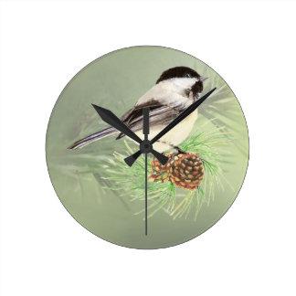Cute Watercolor Chickadee Bird in Pine Tree Round Clock