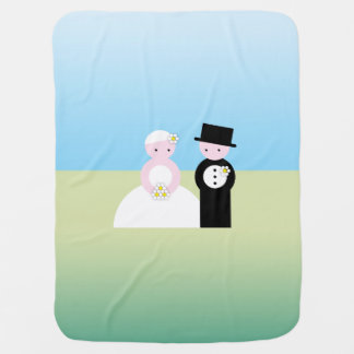 Cute wedding couple receiving blanket