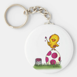 Cute whimsical chick is coloring an Easter Egg by Keychain