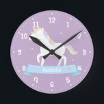 """Cute White Unicorn Girls Bedroom Wall Clock<br><div class=""""desc"""">A wall clock that comes with a cute white unicorn with pastel red, blue and yellow mane which somehow resembles the rainbow. Easy to read white clock face. Perfect for decorating a girls bedroom with an enchanting, magical and fairy tale theme! Personalize with girl&#39;s name on the blue banner with...</div>"""