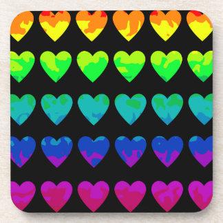 Cute wild rainbow hearts on black beverage coaster