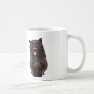 Cute yawning kitty on a mug