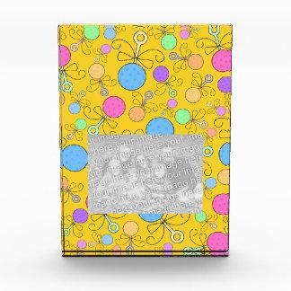 Cute yellow baby rattle pattern award