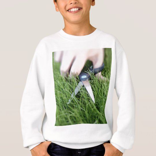 Cutting the grass with a pair of scissors sweatshirt