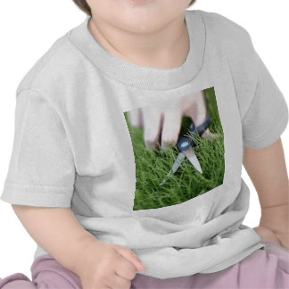 Cutting the grass with a pair of scissors tee shirt