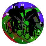 Cycling Trio on Ribbon Road Wall Clocks