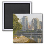 Cyclist along the Seawall Trail in downtown 2 Inch Square Magnet