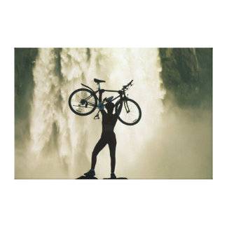 Cyclist in Front of Waterfall Canvas Print