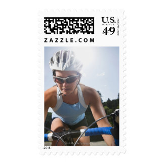 Cyclist on mountain road postage stamp