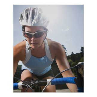 Cyclist on mountain road poster