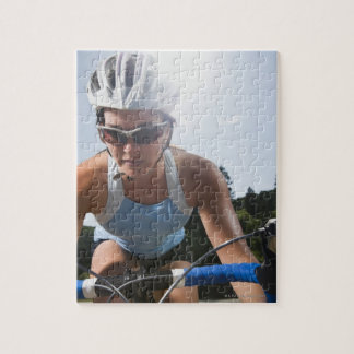 Cyclist on mountain road jigsaw puzzle