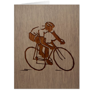 Cyclist silhouette engraved on wood design card