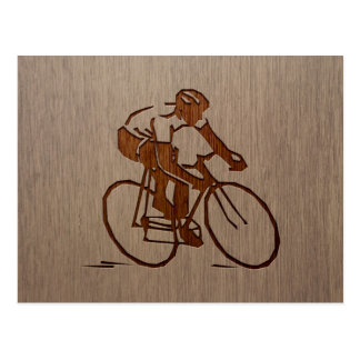 Cyclist silhouette engraved on wood design postcard
