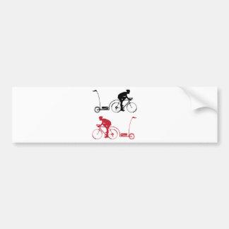 Cyclist with a trailer bumper sticker