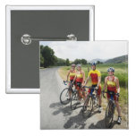 Cyclists posing on country road button