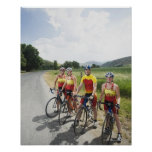 Cyclists posing on country road poster