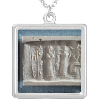 Cylinder seal depicting an evocation to the silver plated necklace