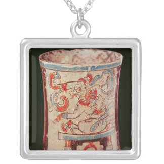 Cylindrical depicting a deity with speech curls silver plated necklace