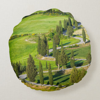 Cypress lined winding road in Tuscany round pillow