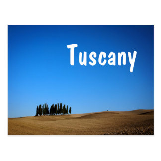 Cypress trees and barren hills with Tuscany text Postcard