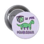 D está para el botón del dinosaurio pin