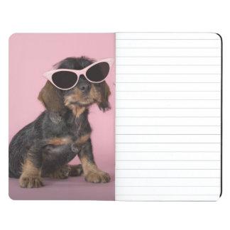 Dachshund puppy wearing sunglasses journal
