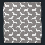 "Dachshund White Silhouettes on Dove Grey Bandana<br><div class=""desc"">Dachshund White Silhouettes on Dove Grey  White outlined silhouettes on Dove Grey background of the short-legged Dachshund,  beloved by its owners for its feisty and clever temperament. Bred to ferret out badgers and other ground burrowers,  the tiny dog is not short on personality.</div>"