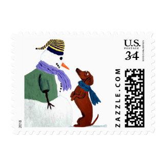 Dachshund y muñeco de nieve sello postal