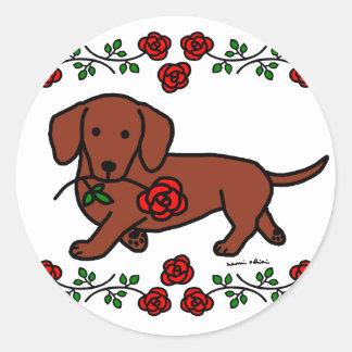 Dachshund y un dibujo animado de la flor pegatina redonda
