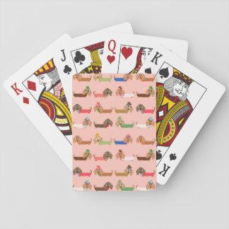 Dachshunds en rosa barajas de cartas