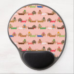 "Dachshunds on Pink Gel Mouse Pad<br><div class=""desc"">Dachshunds on Pink, an adorable dog design that dog lovers, especially Dachshund lovers, will find too cute to resist! Features Dachshunds in sweaters of chocolate brown, green, blue, coral, pink, and white, some wearing eye glasses, some with bows or even top hats! This cute dachshund design is available on bags,...</div>"