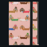 """Dachshunds on Pink iPad Mini Cover<br><div class=""""desc"""">Dachshunds on Pink, an adorable dog design that dog lovers, especially Dachshund lovers, will find too cute to resist! Features Dachshunds in sweaters of chocolate brown, green, blue, coral, pink, and white, some wearing eye glasses, some with bows or even top hats! This cute dachshund design is available on bags,...</div>"""