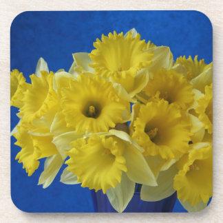 daffodils on blue cork coasters