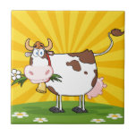 "Dairy Cow Ceramic Tile<br><div class=""desc"">Dairy Cow With Flower In Mouth On A Meadow And Sunburst</div>"