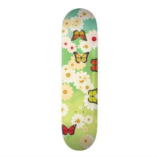 Daisies and butterflies skateboard deck
