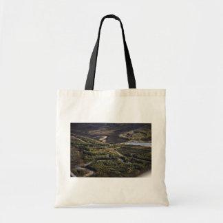 Dalton Highway crossing Bonanza Creek Canvas Bags
