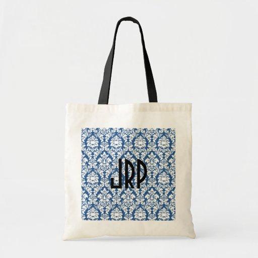Damasco azul con monograma bolsa de mano