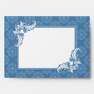 Damasco del azul de acero y boda floral del marco sobres