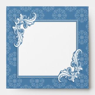Damasco del azul de acero y marco floral sobres
