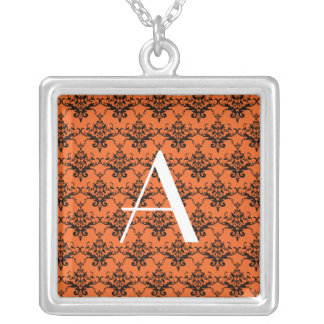 Damasco del naranja del monograma joyeria