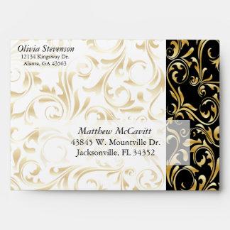 Damasco elegante del oro, blanco y negro sobres