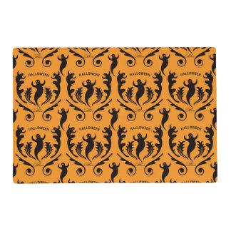 Damasco negro del fantasma en el naranja tapete individual