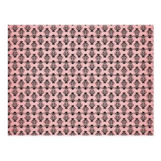 Damasco negro en fondo rosado descolorado postal