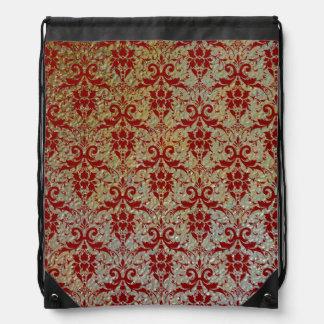 Damasco rojo de lujo en mirada sellada de la textu mochila