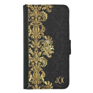 Damascos negros y cordón floral del oro metálico