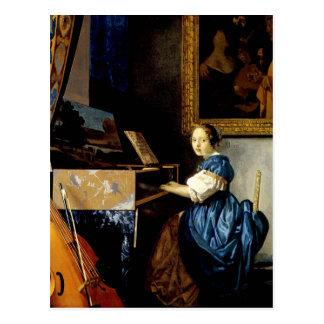 Dame on spinet by Johannes Vermeer Postcard