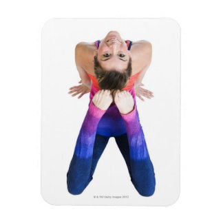 Dancer touching feet to head magnet